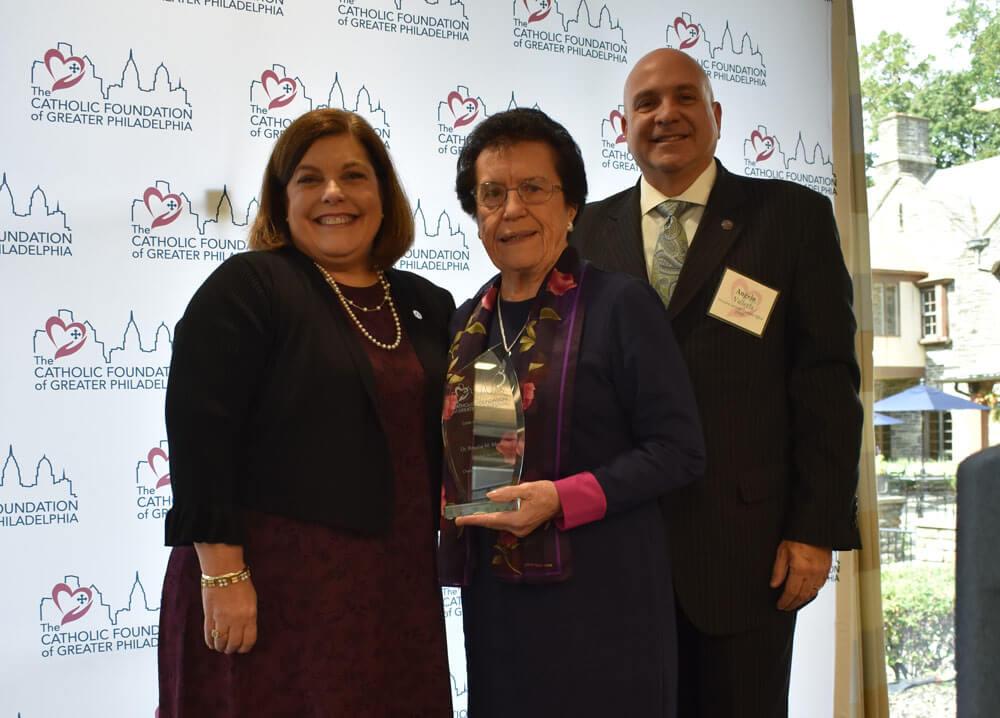 Dr. Rosalie M. Mirenda receiving her Women in Philanthropy award