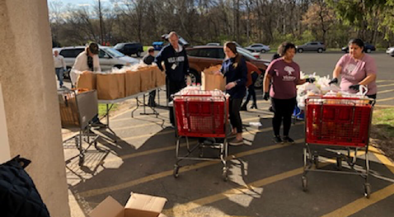 Loading up carts of food at the Montgomery County Family Service Center