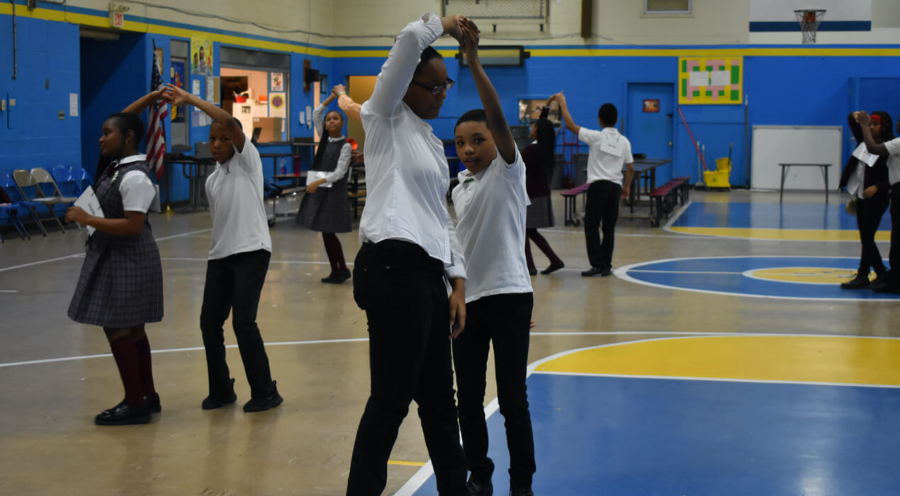 Students Learning how to dance in the gym
