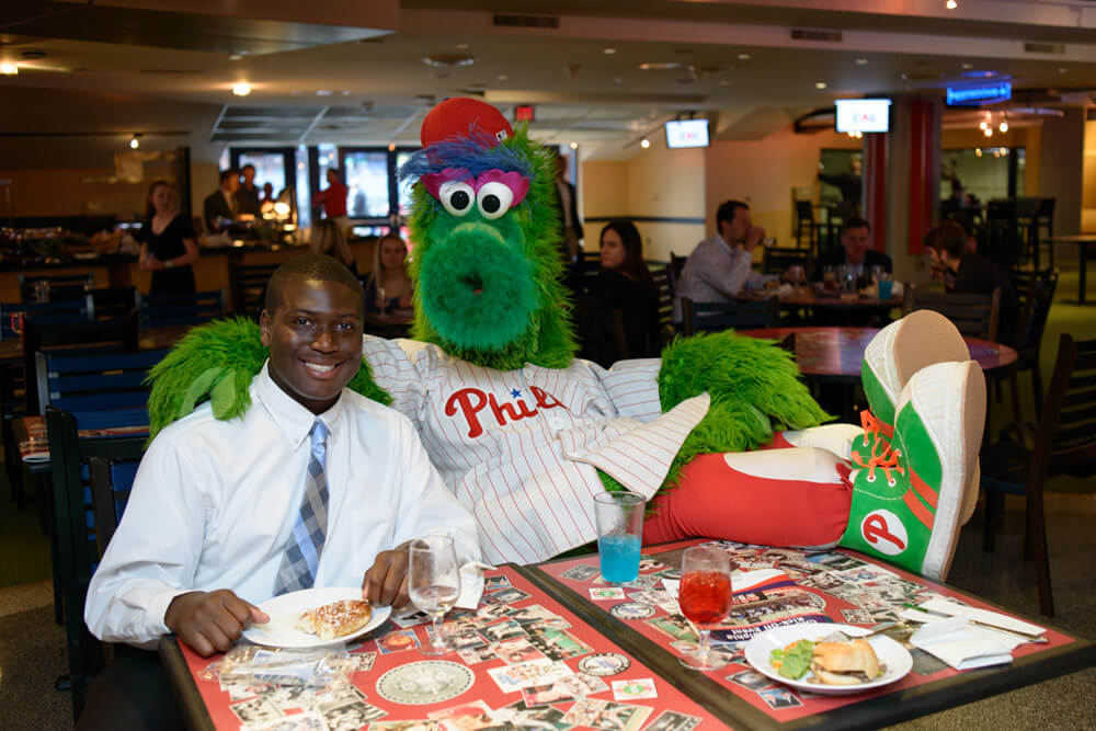 Phillie Phanatic posing with a CAC member during lunch