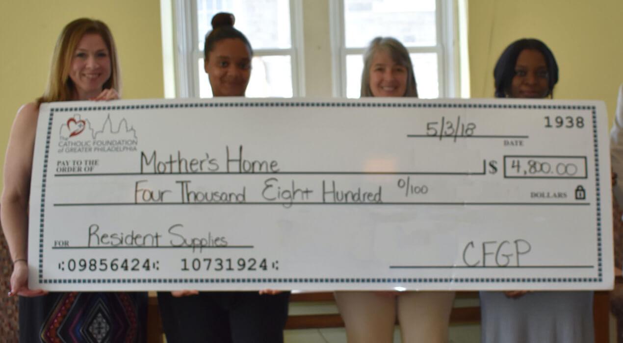 Four women receiving their CFGP grant