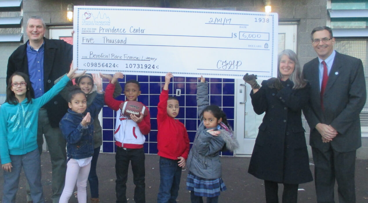 Children from the Providence Center receiving their grant