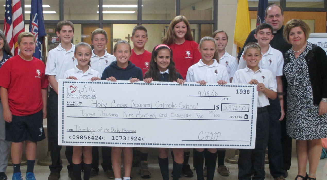 Students from Holy Cross Regional Grant receiving their grant