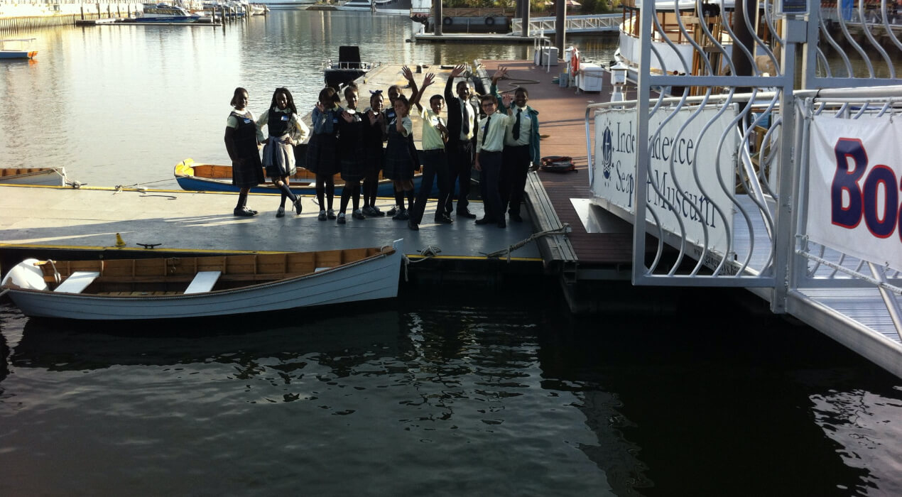 Students from St. Francis de Sales School out on a dock by the water